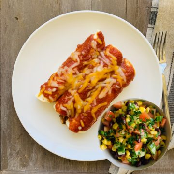 Chicken enchiladas with black bean corn salad
