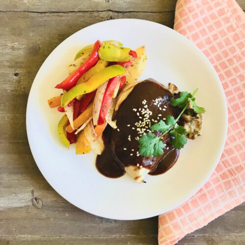 Mole chicken with sautéed peppers and onion