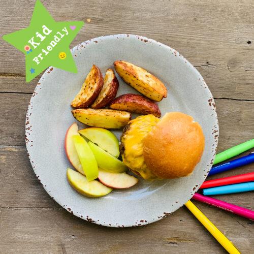 Kid's Menu: Cheeseburger, potato wedge and apple