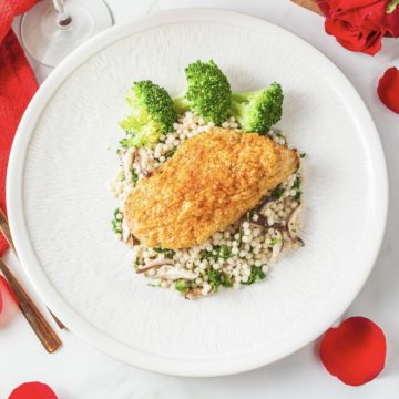 Hummus crusted chicken with Israeli couscous